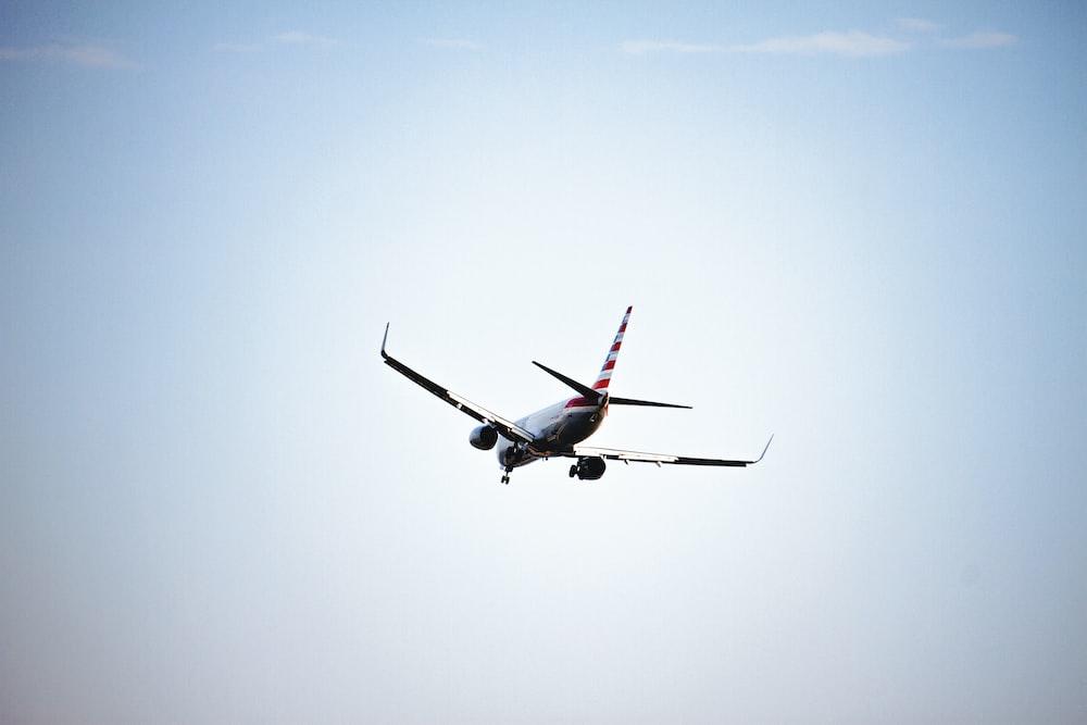 white airplane in flight