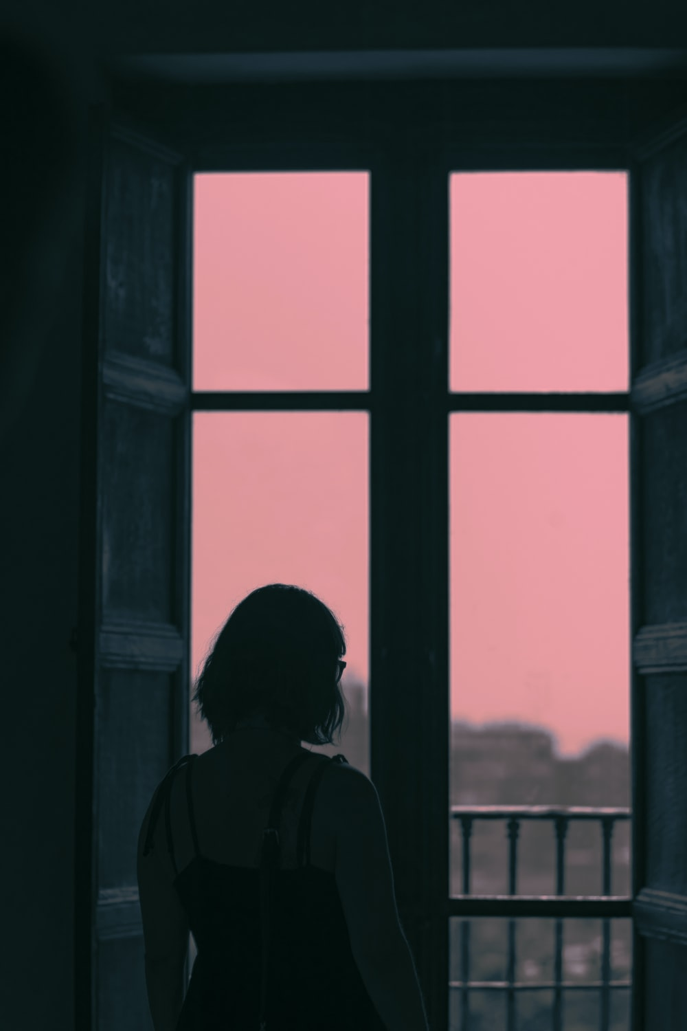 woman standing in front of window