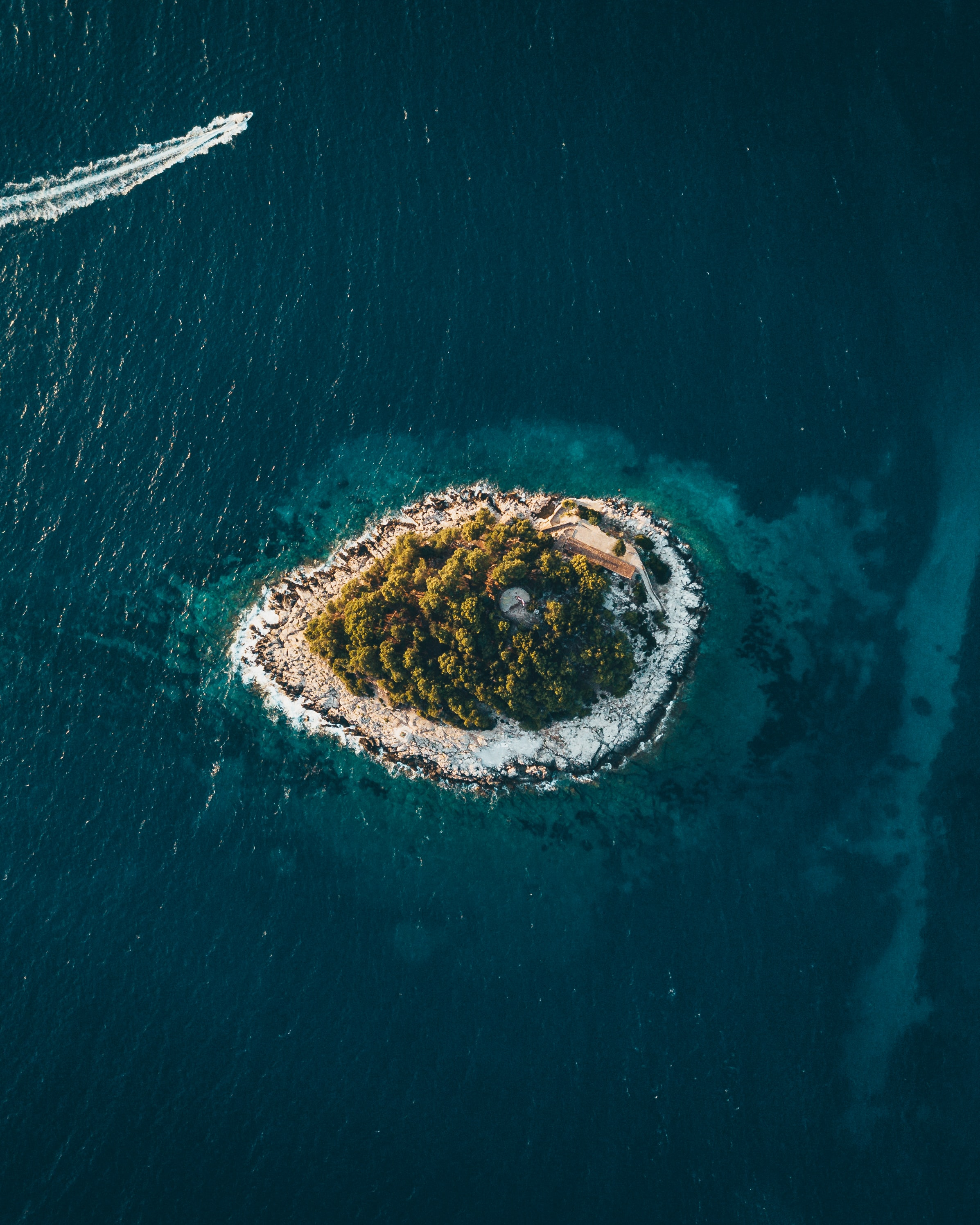 aerial photography of island surrounded by sea