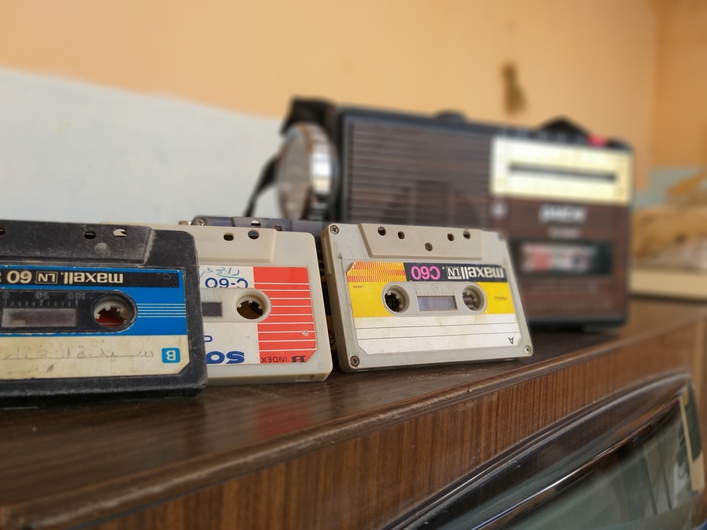 cassette tapes on brown wooden surface
