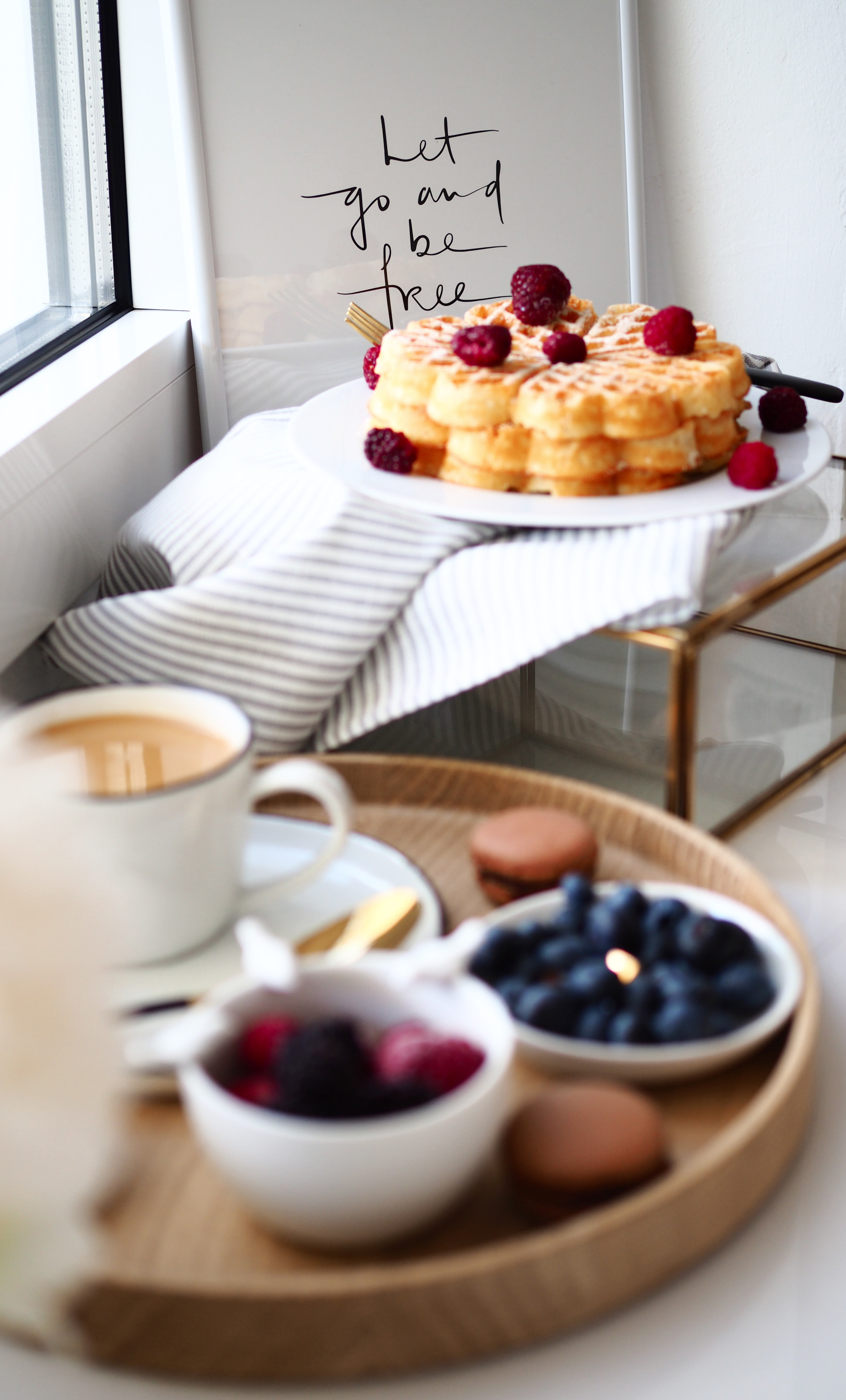 shallow focus photography of waffles with raspberries
