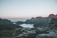 photography of mountain near sea