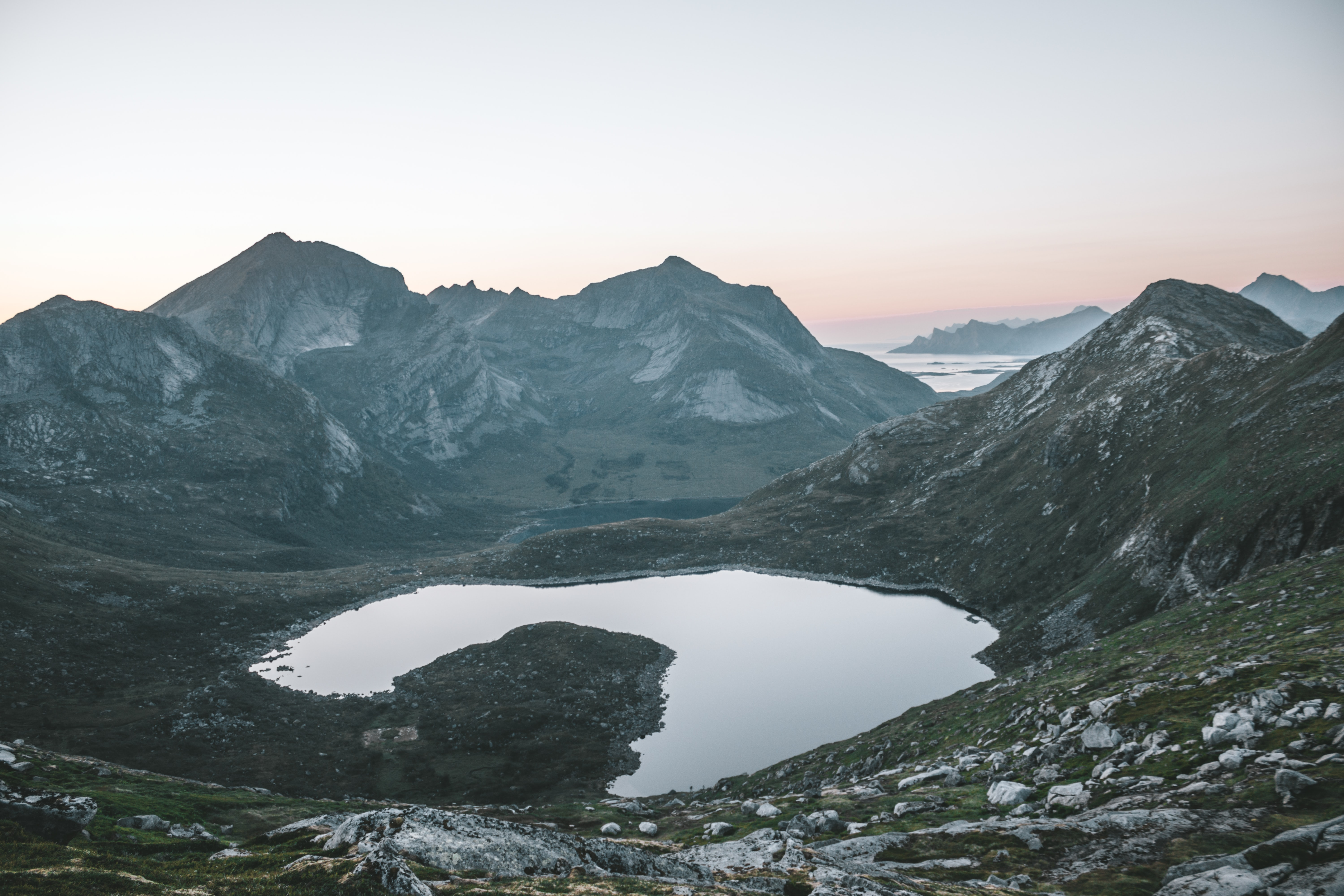 photo of mountains and body of water