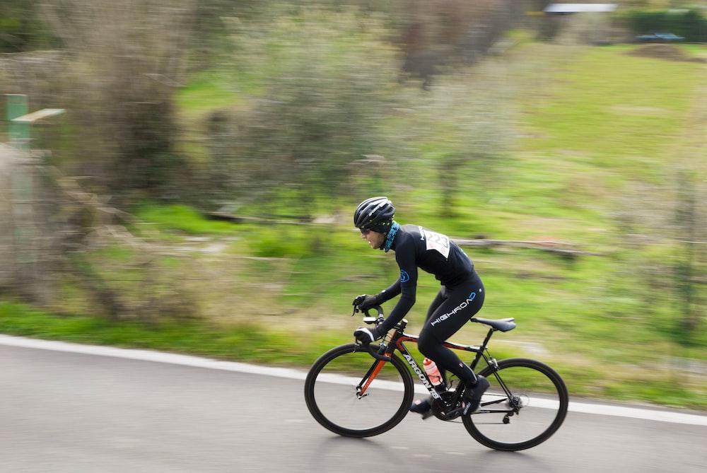 man riding mountain bicycle during daytime