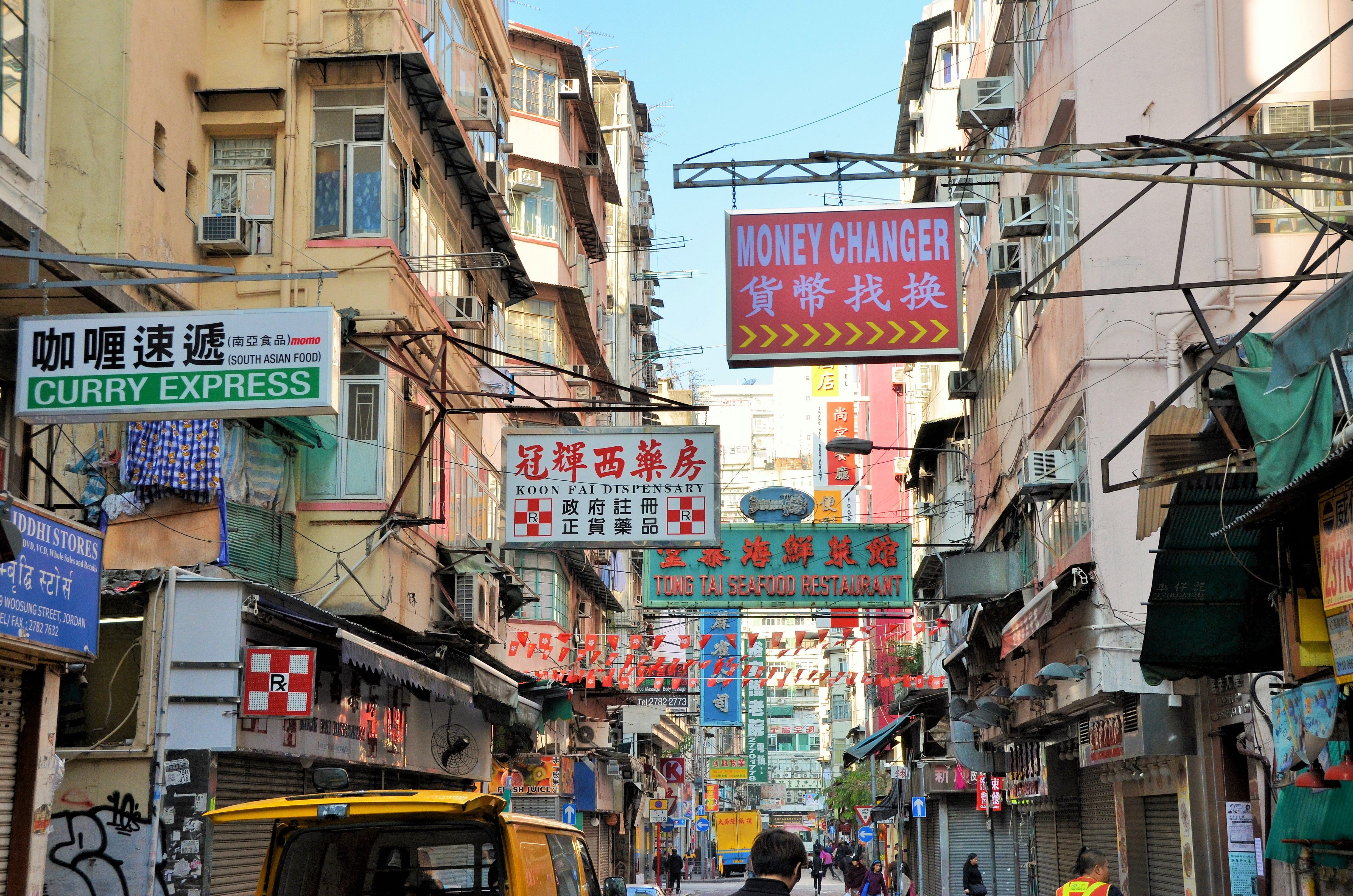 assorted store signages hanging on street