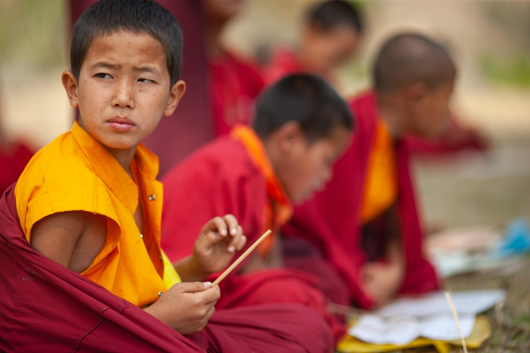 On our visit to one of the many monasteries in Bhutan, came across a group of young buddhist monks who are studying in an outdoor class. Most of the boys are studying intently and as we walk passed, one of them look out and that's where this shot was framed. Life in Bhutan is simple and at that time Internet and mobile was not pervasive as yet, however the people all have this light and sparkle in their eyes much more so than some of their western counterparts who are much more technologically advance but walk around with a glazed eyes staring into their cellphones.