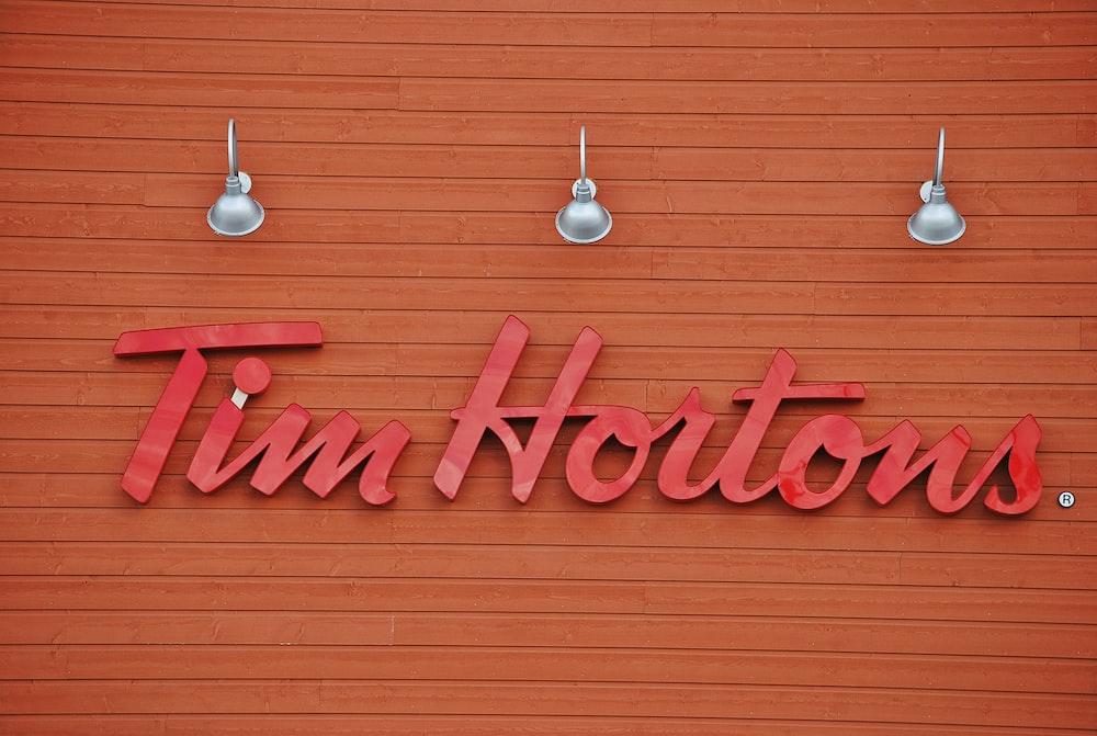Tim Hortons signage under three gray lights