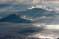 mountain range covered in clouds