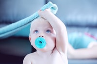 baby with pacifier in mouth