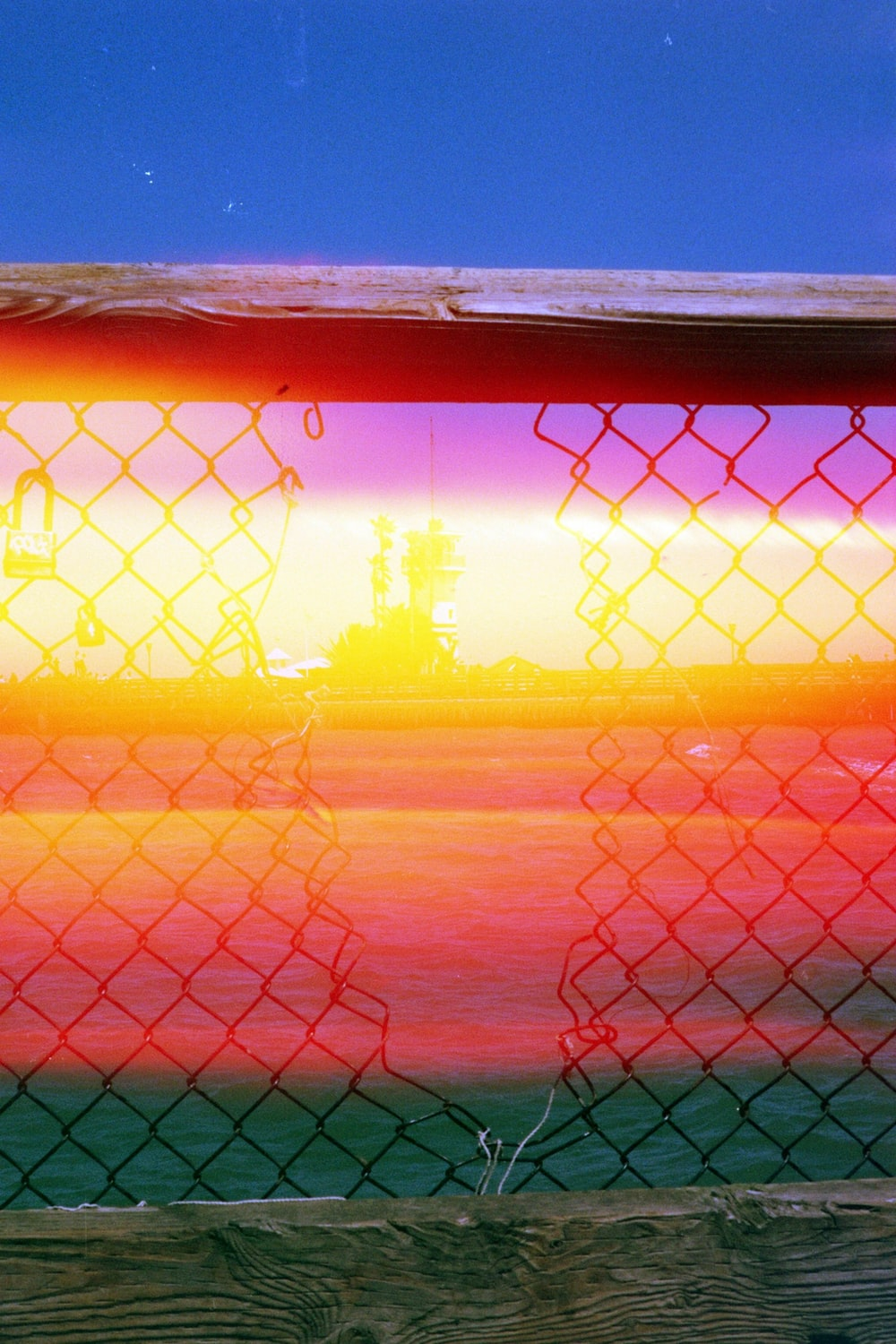 silhouette photo of mesh fence
