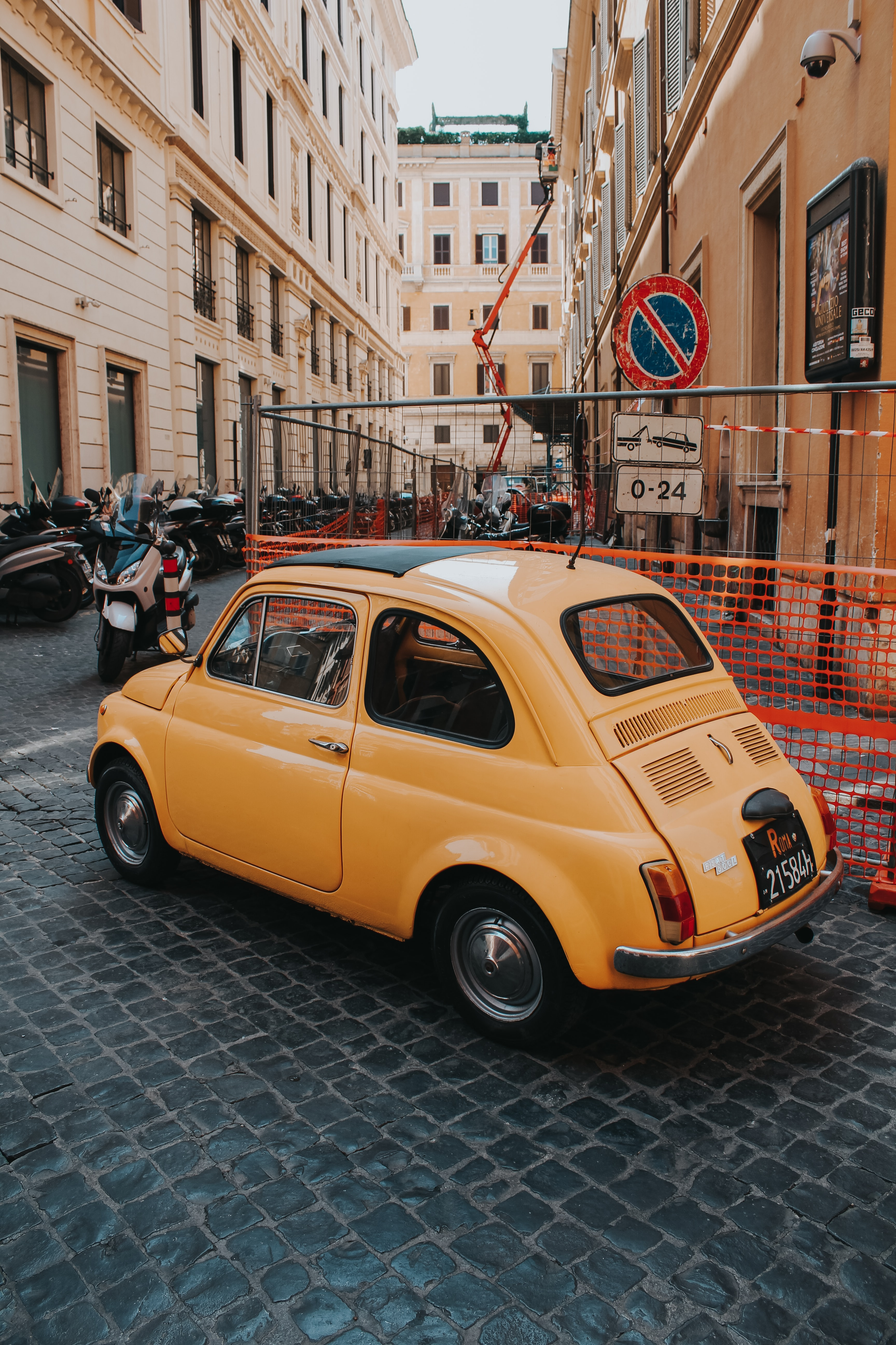 orange beetle-style car parked near building