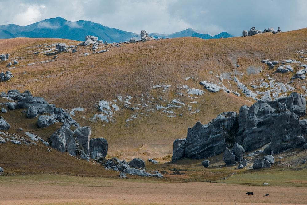 rock formations near mountain taken during daytime