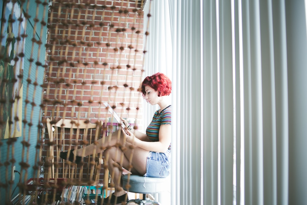 woman sitting on gray floor
