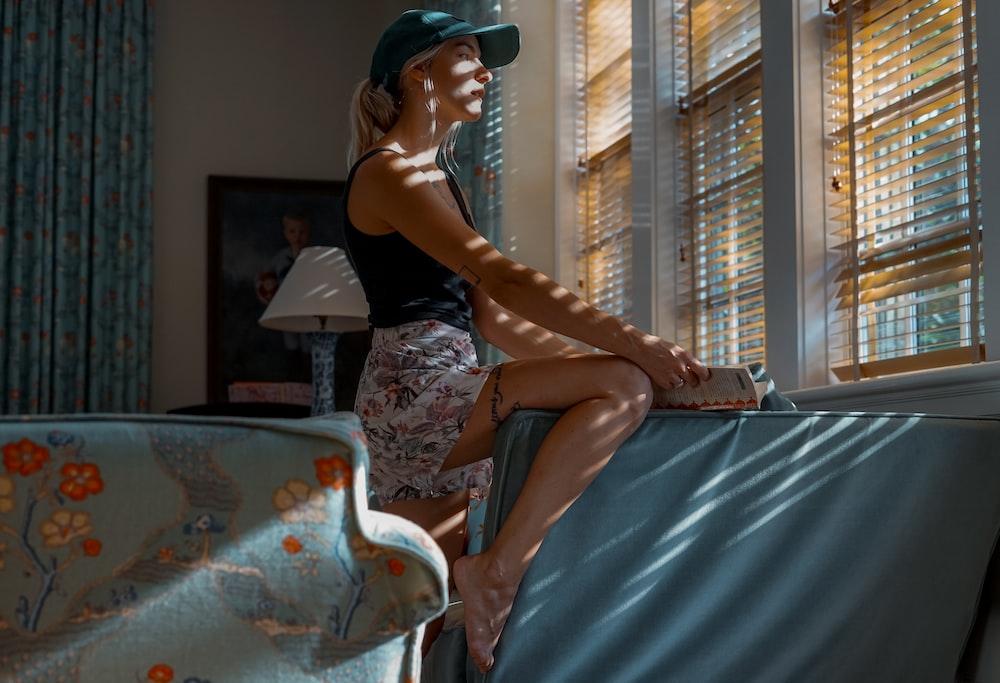 woman staring at window
