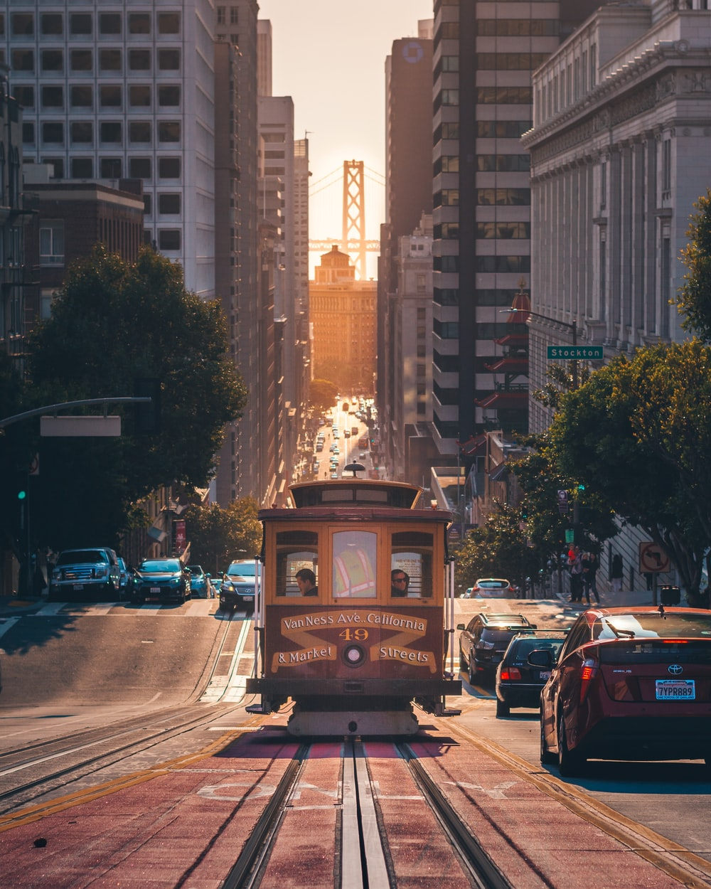 grey cable car between buildings