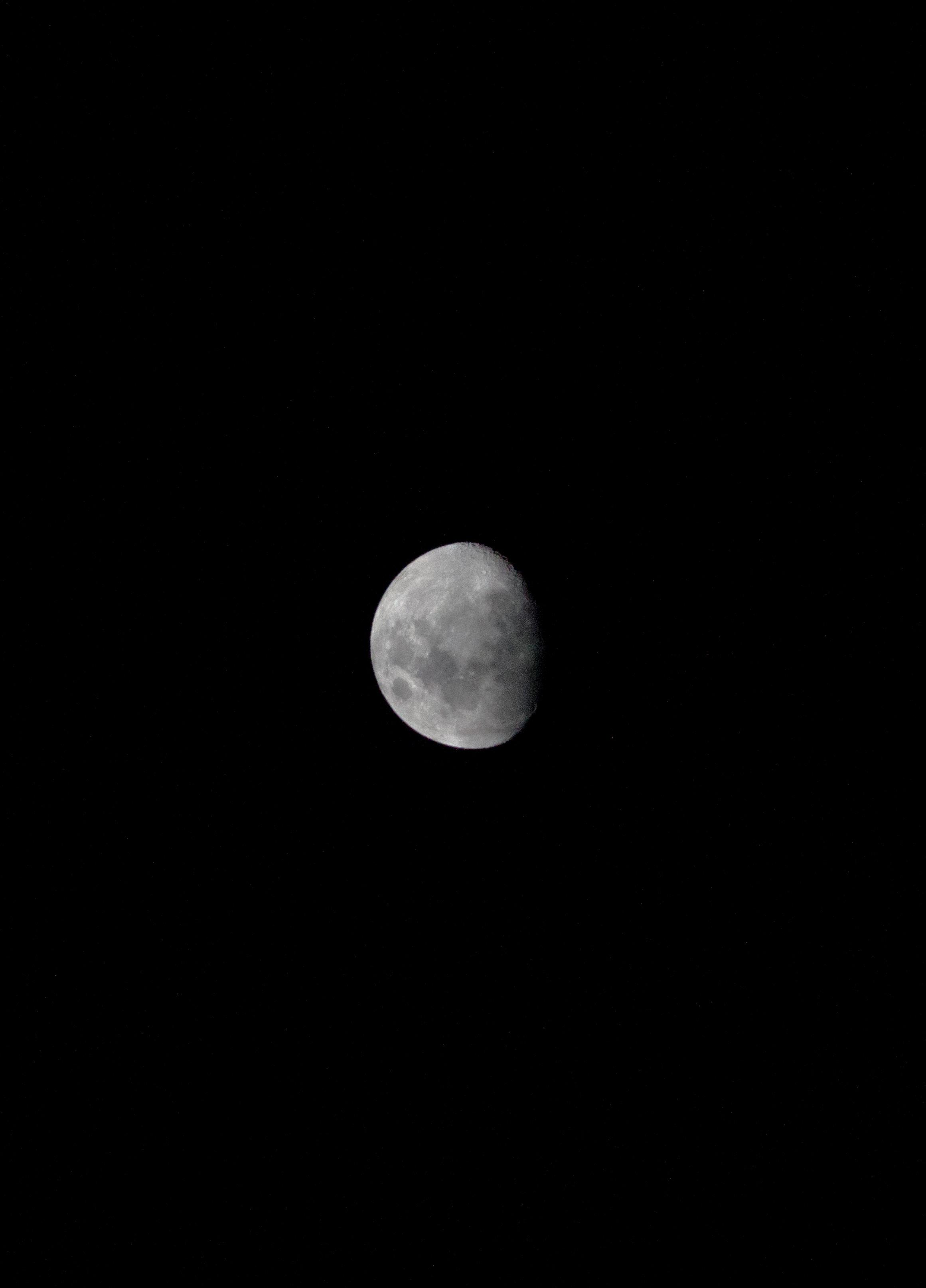 waxing moon in night sky