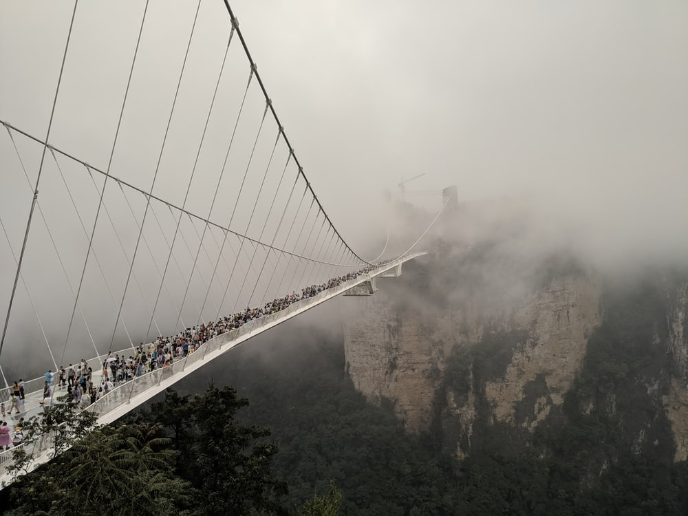 group of people at glass bridge