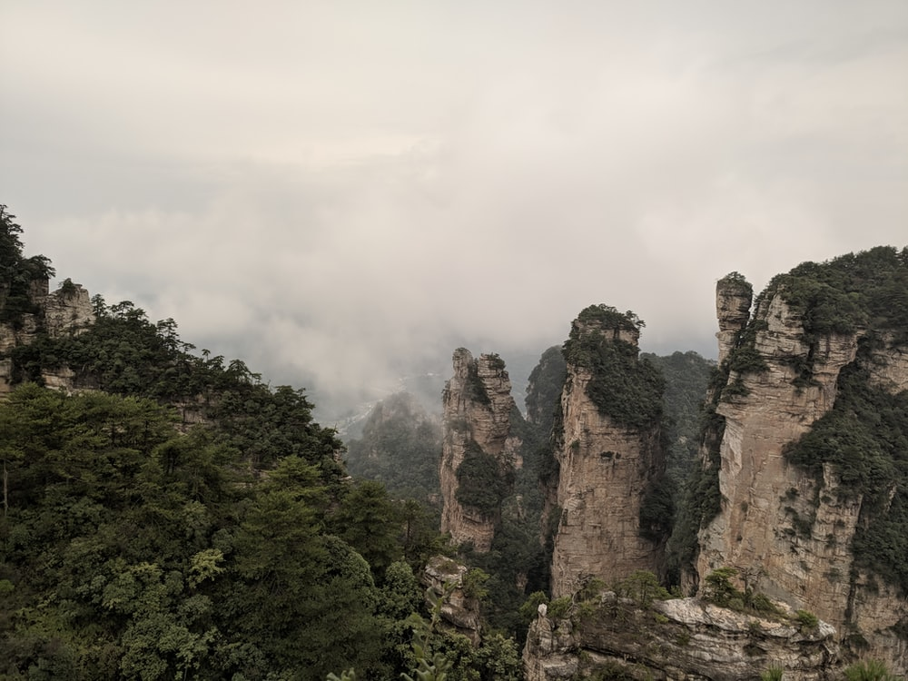 rocky mountain under white sky