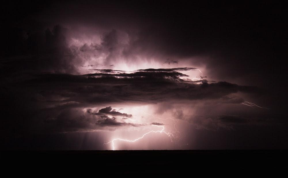 lightning under white clouds wallpaper