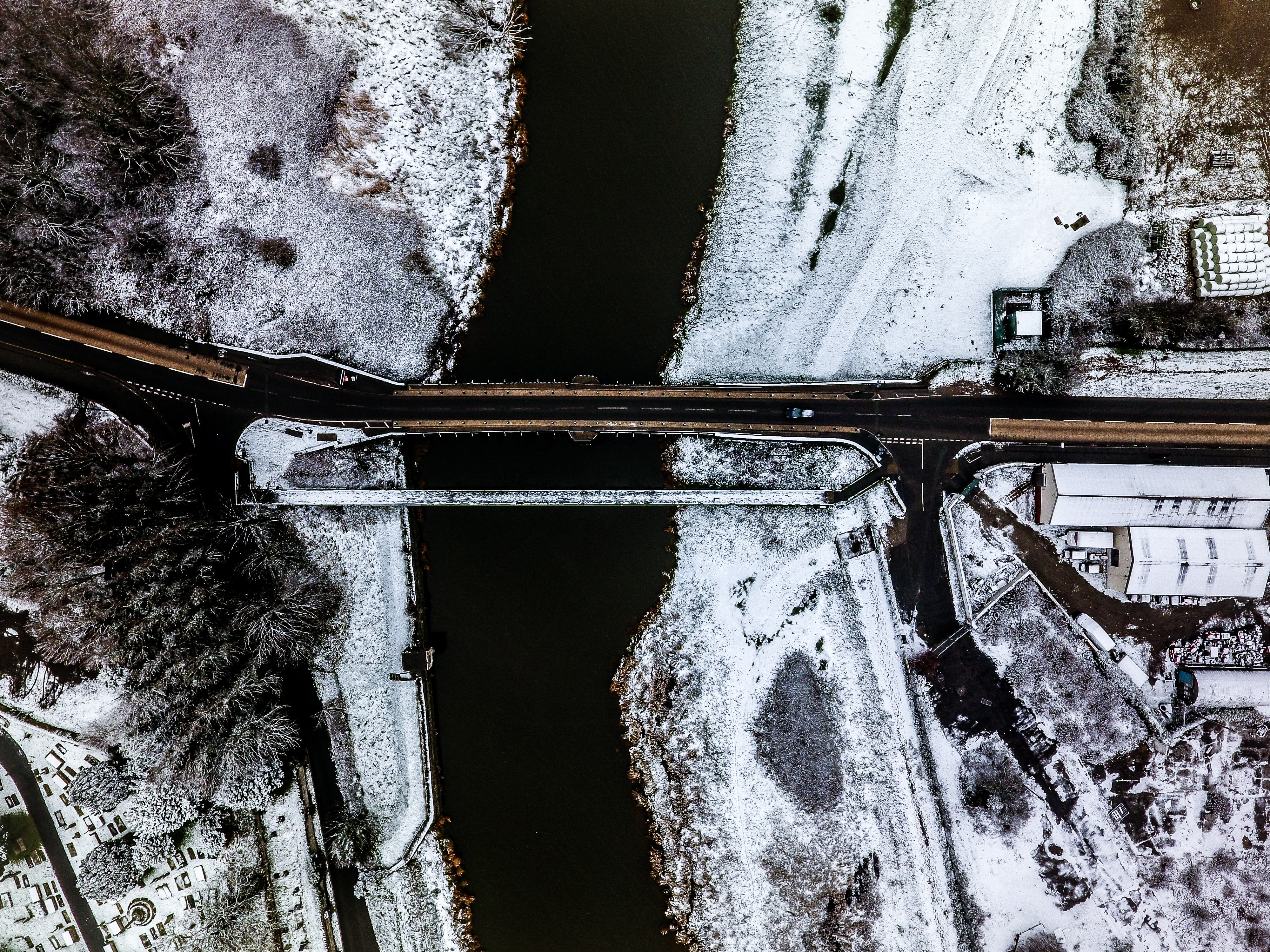 aerial view of bridge near snow covered area