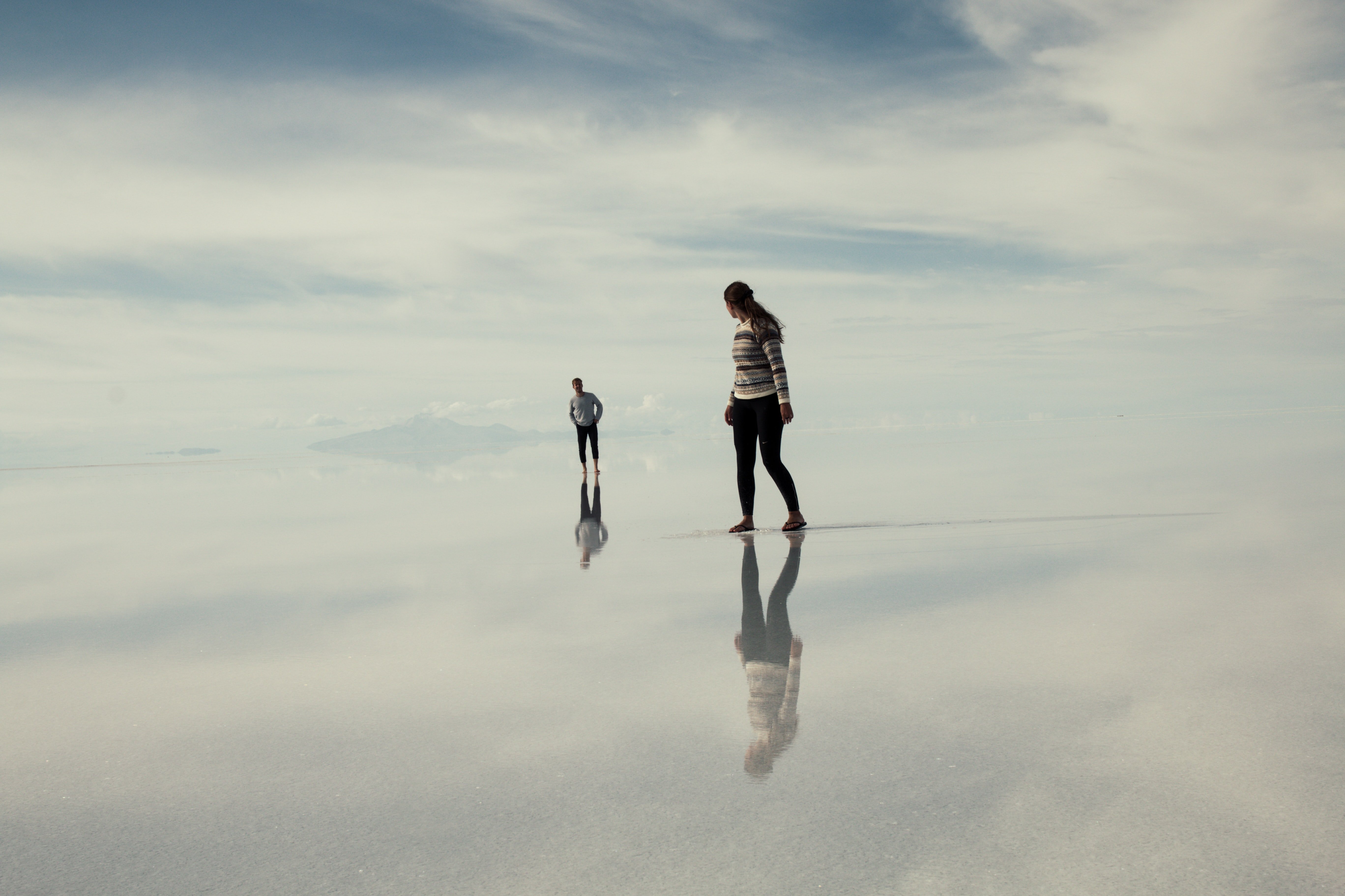 man and woman walking on clouds