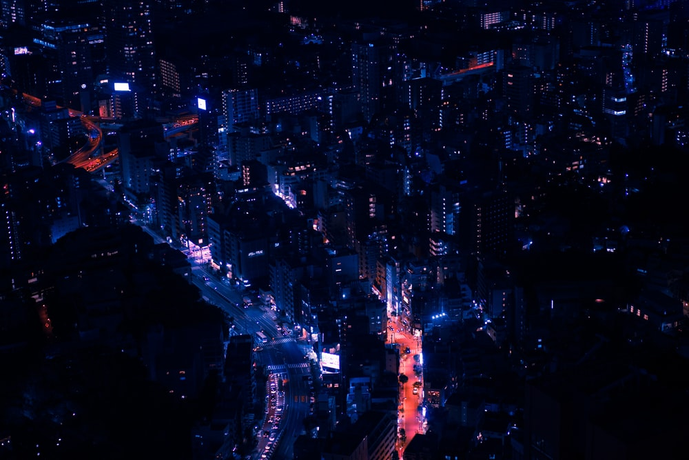 aerial view photography of lighted city buildings during nighttime