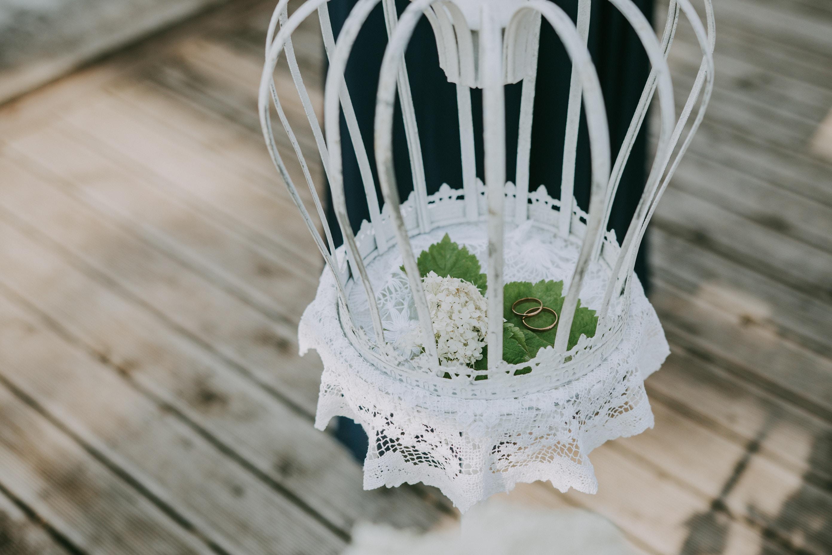 photo of ring inside white lantern decor