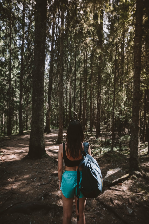 woman facing trees