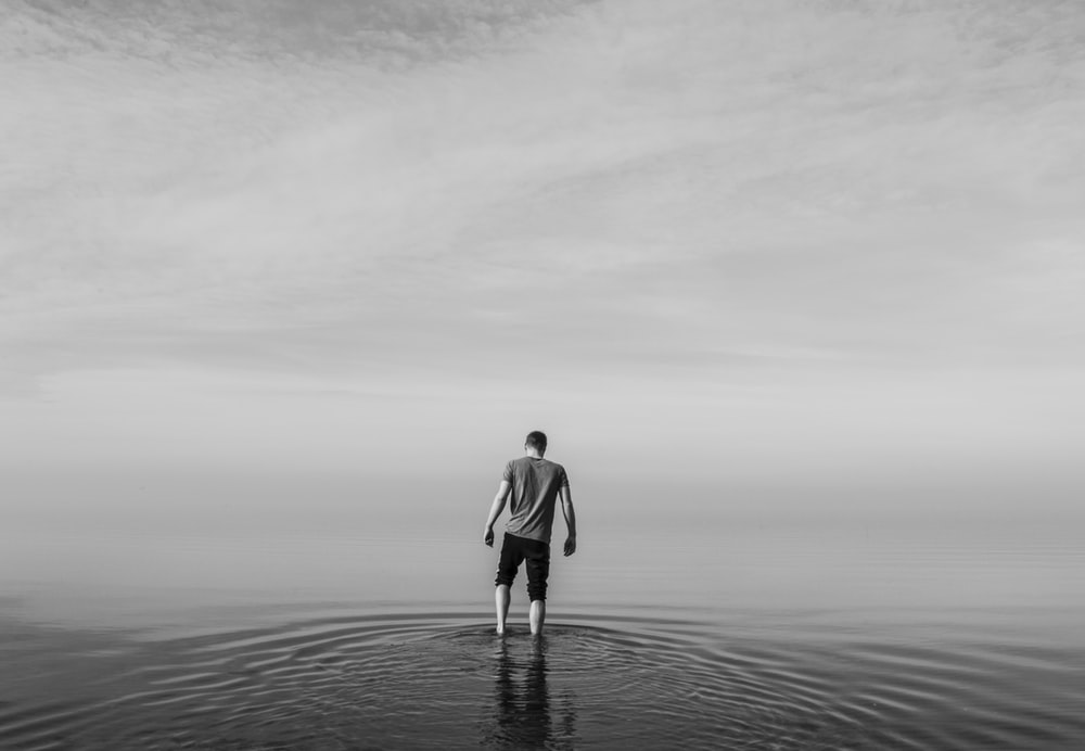person standing in body of water