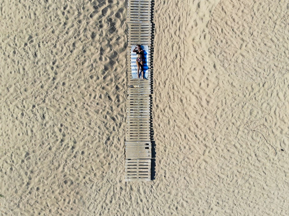 aerial photography of woman sunbathing outdoors