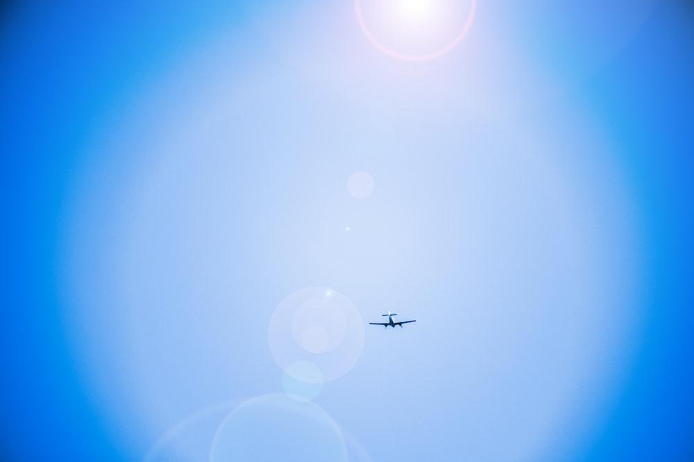 black airplane flying on air