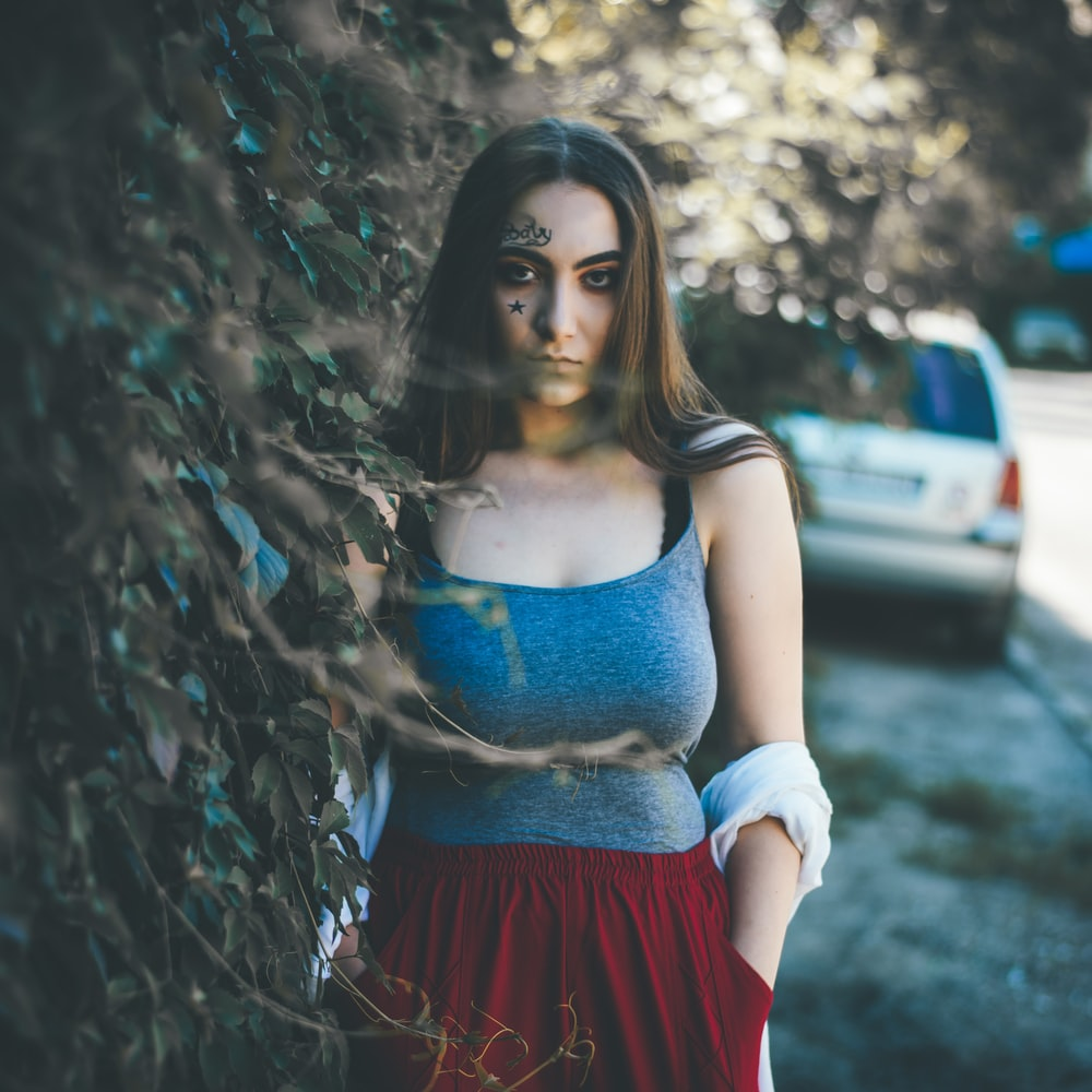 woman standing near car