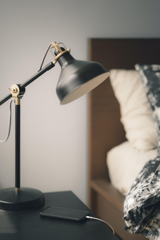 turned off black task lamp