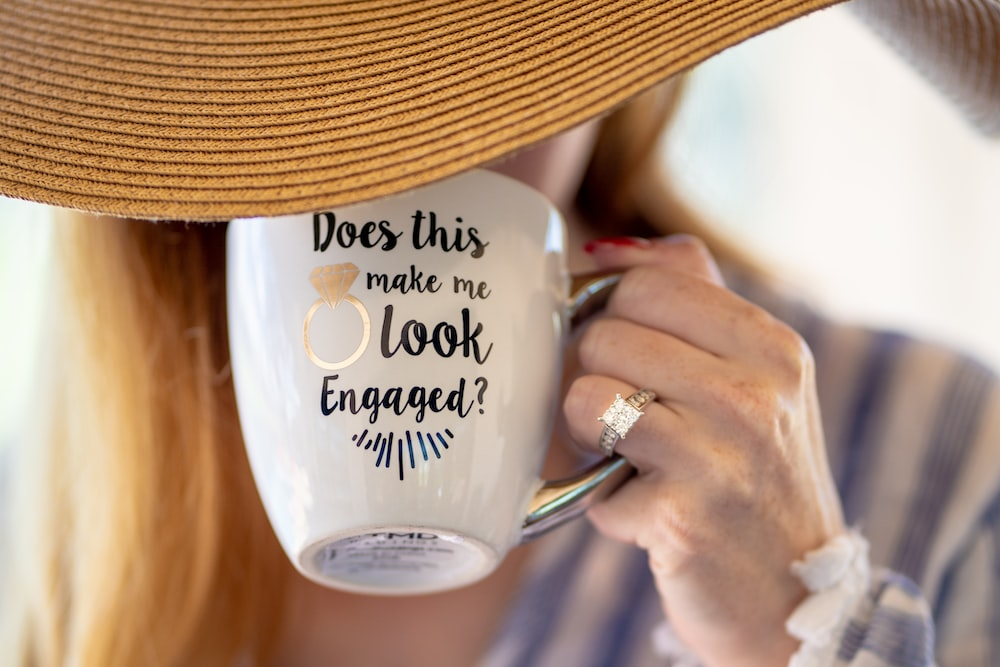 person holding white ceramic mug