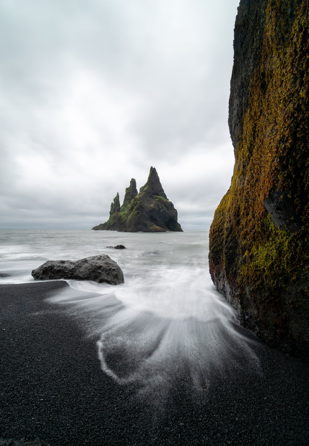 time lapse of shore near rock formation at daytime