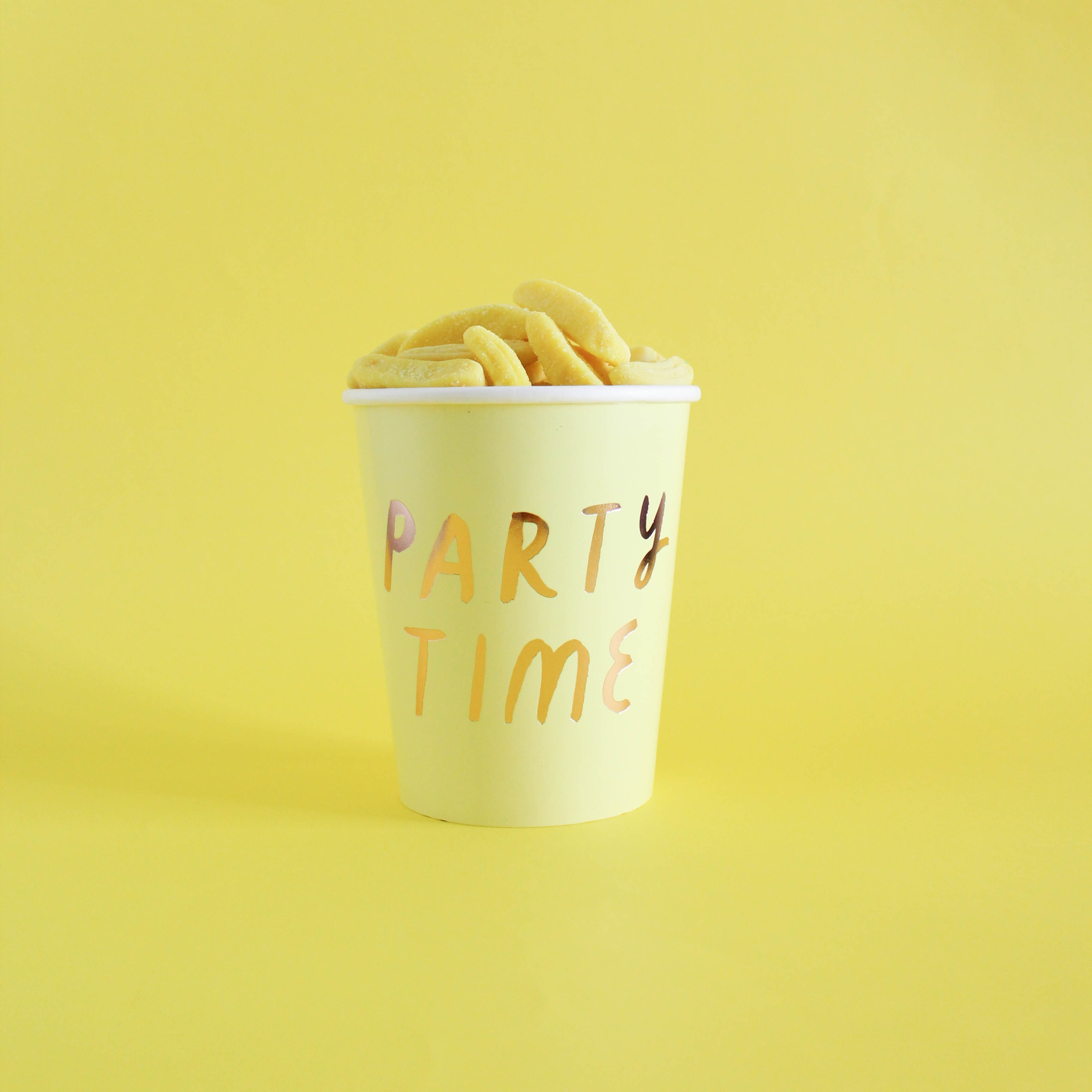 Party Time cup on yellow surface