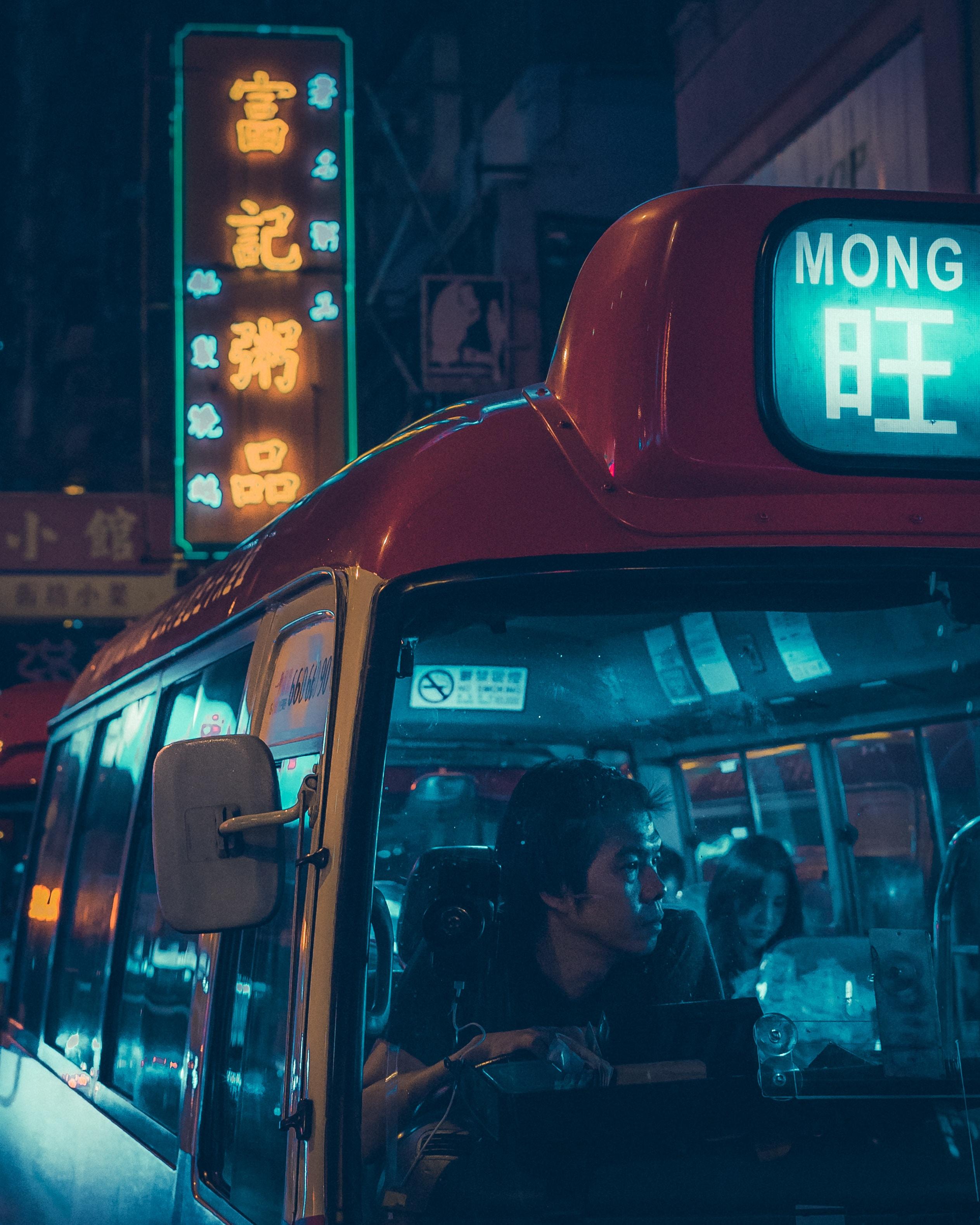 people riding bus during nighttime