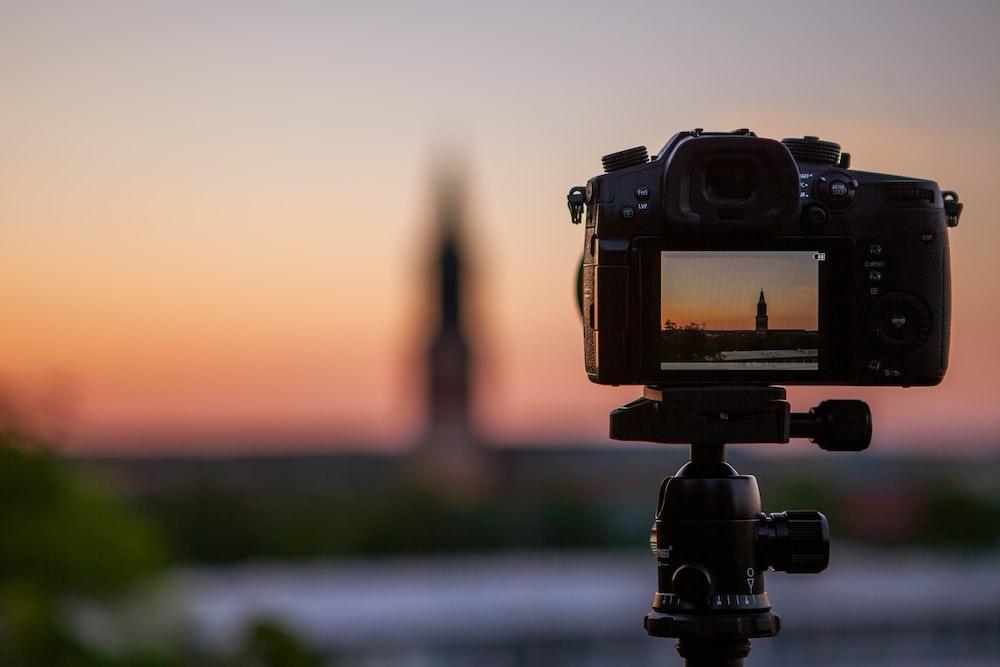 shallow focus photography of black DSLR camera