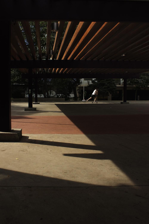 man skateboarding in open space