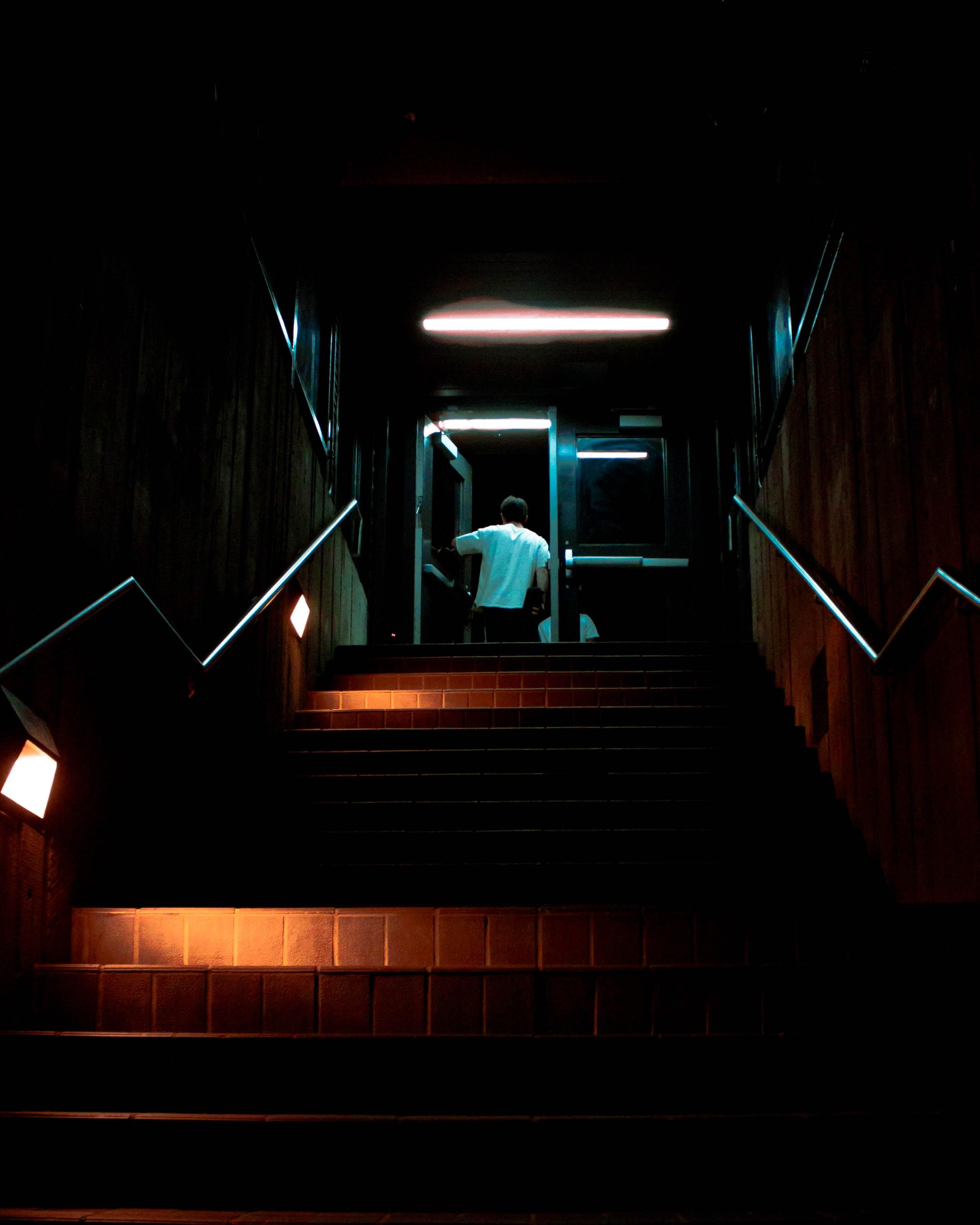 man standing beside glass door