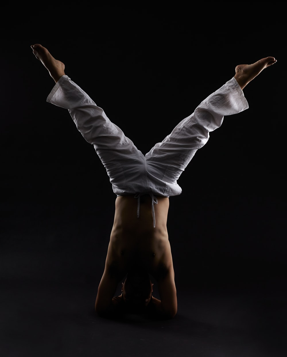 man doing head stand