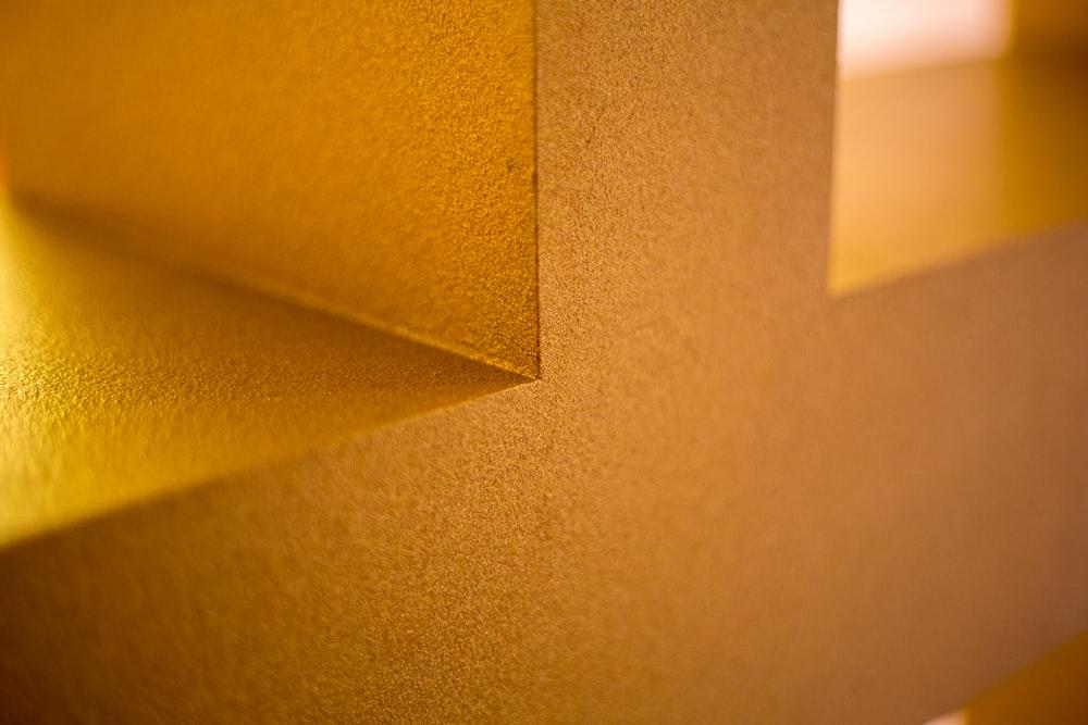 closeup photo of yellow wall