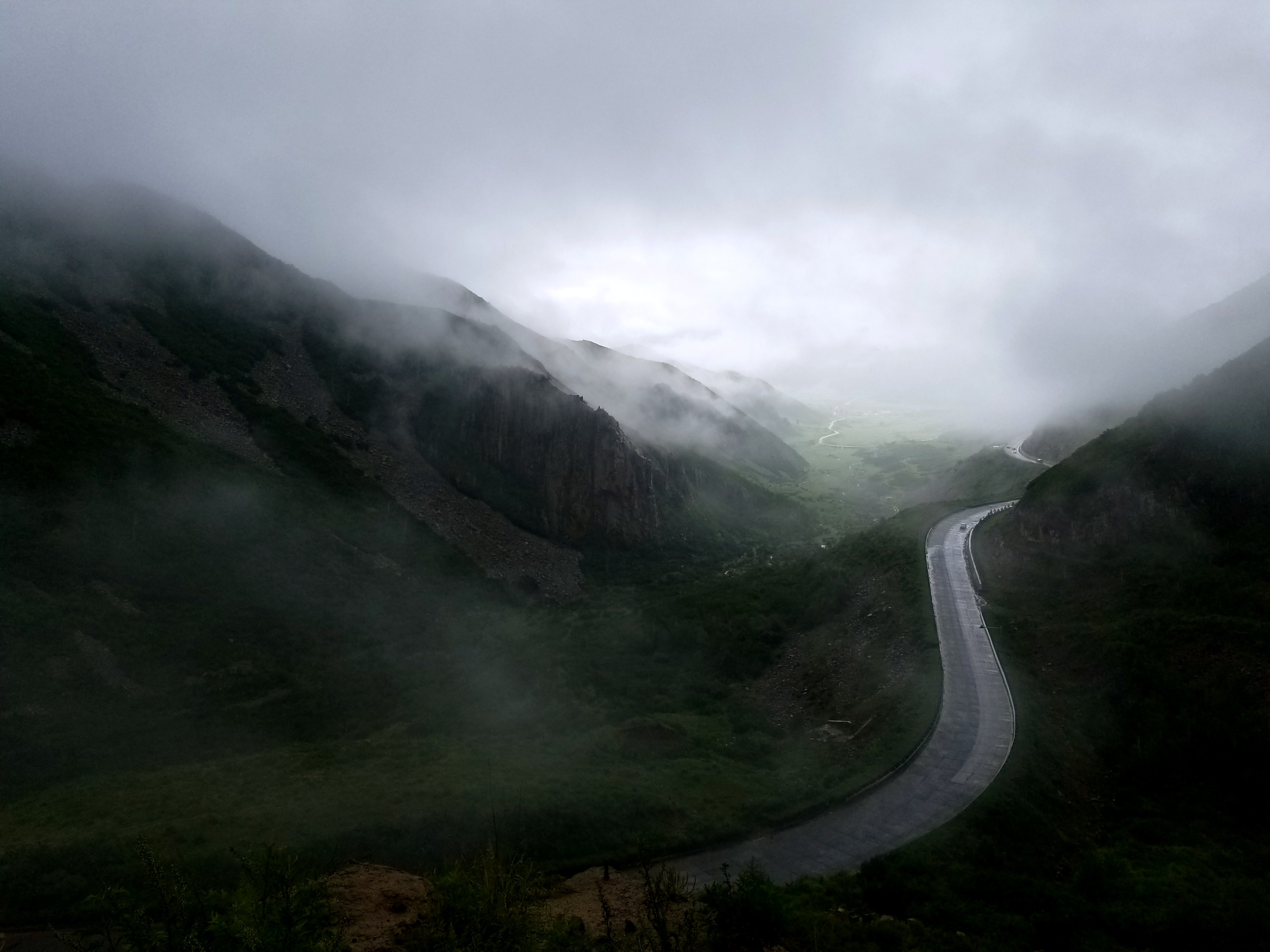 landscape photography of road near mountains