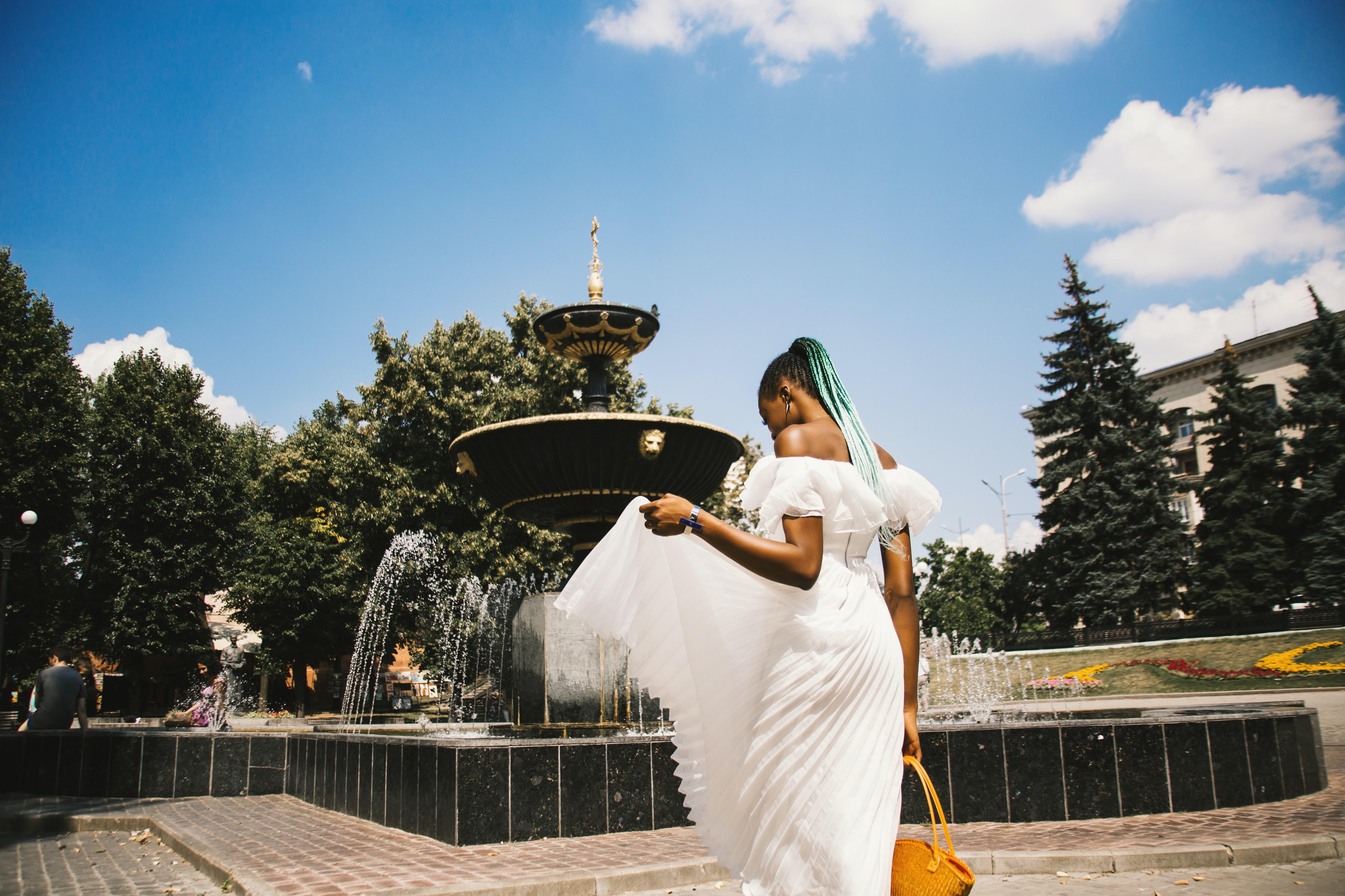 woman standing near water fountain