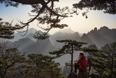 A quiet moment on Mount Huangshan after one of the most incredible sunrises I've ever witnessed. See more at www.morethanjust.photos