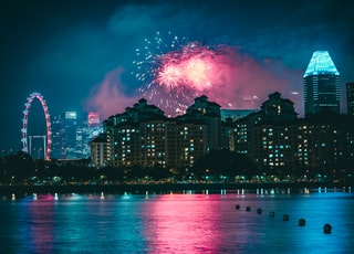 fireworks above high-rise buildings at nighttime