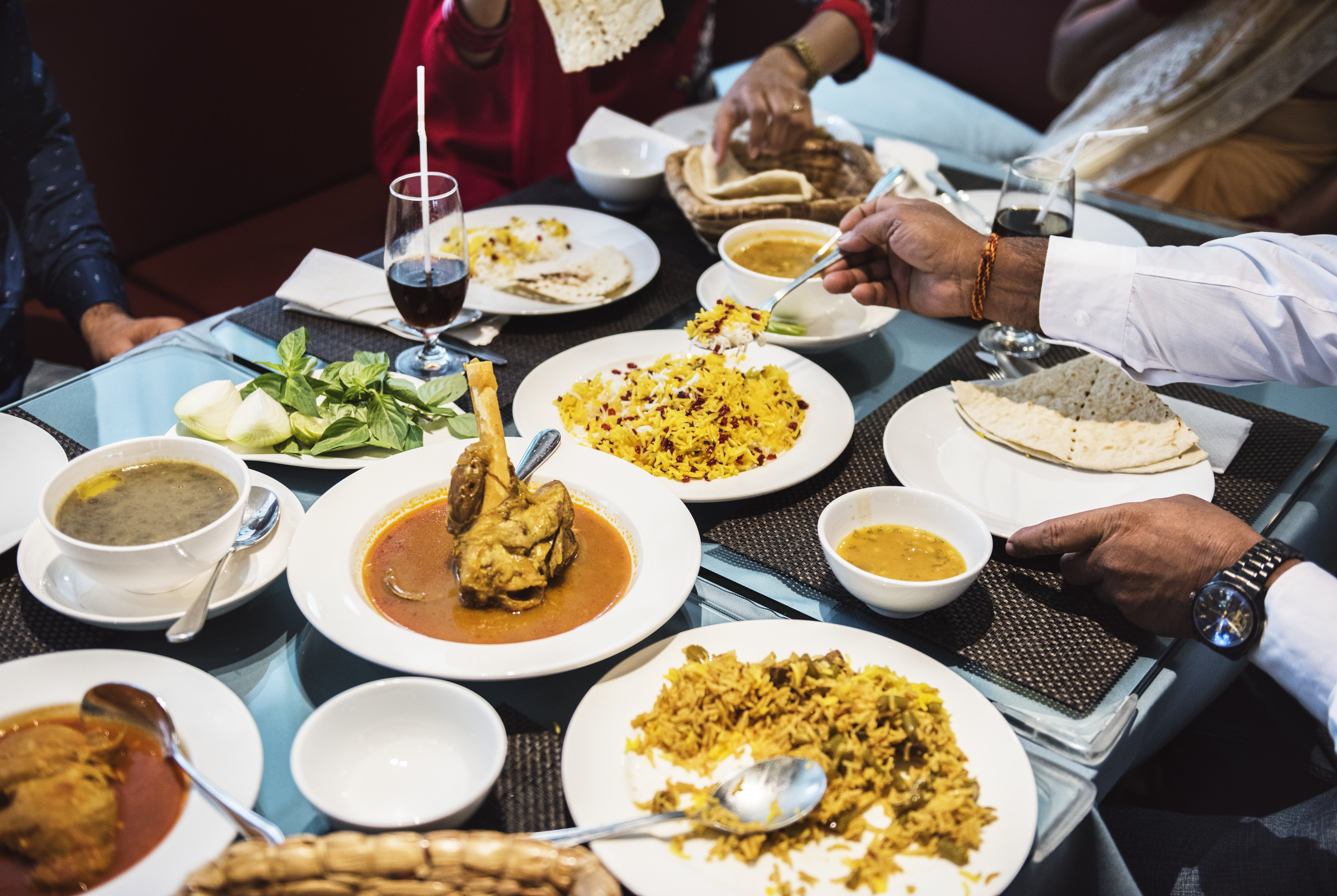 group of person facing table with cooked dishes
