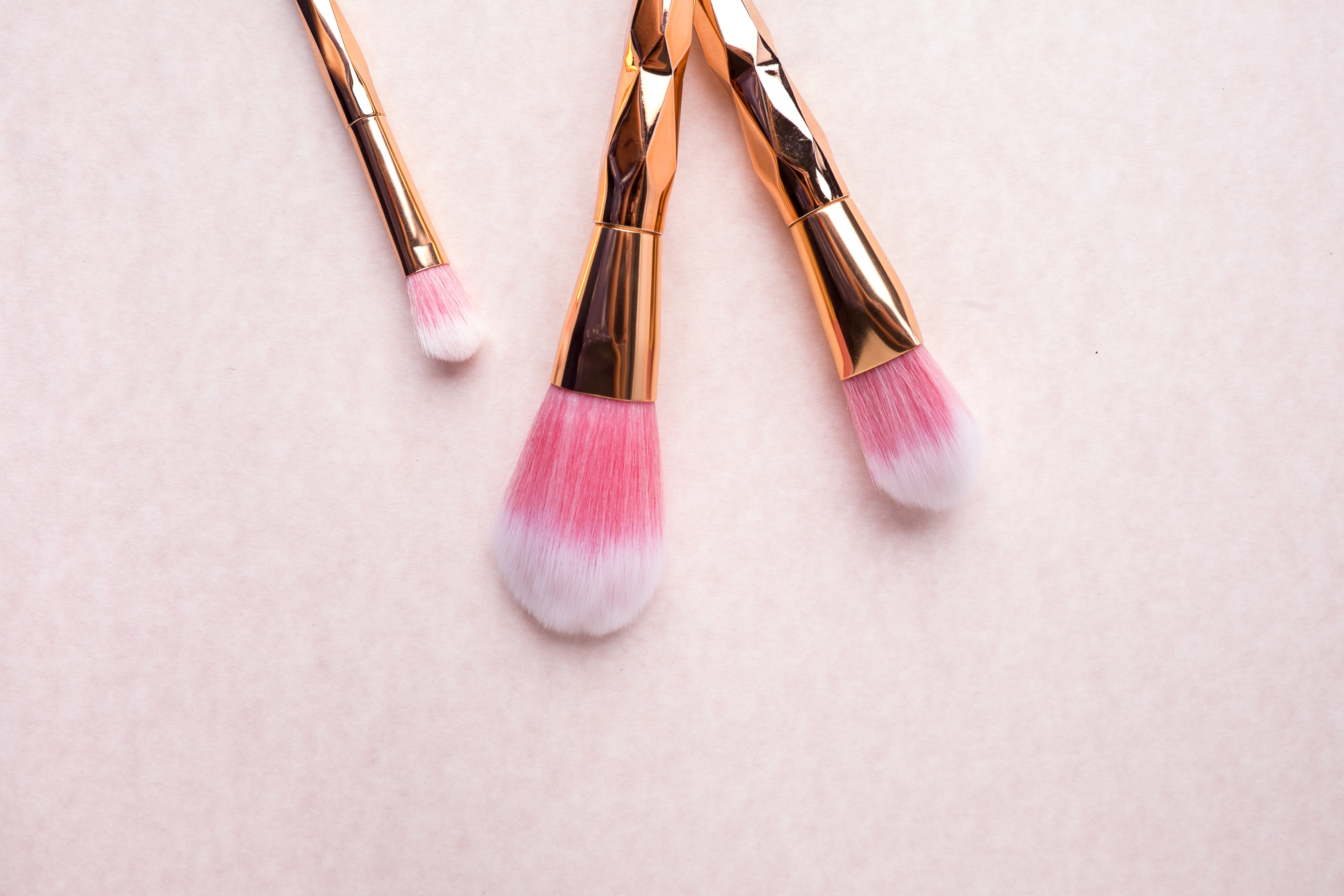 gold-colored makeup brushes