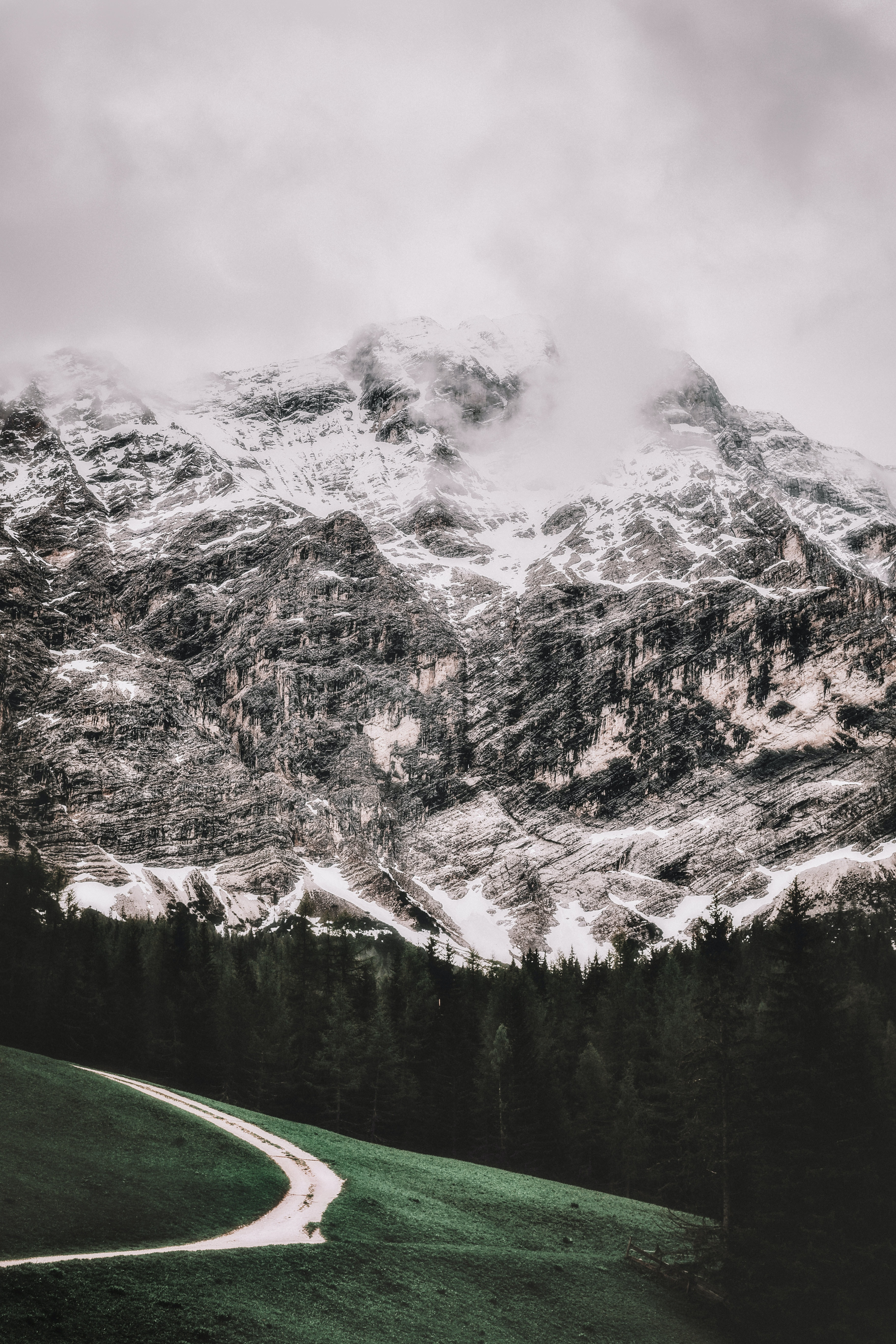 icy mountain under white clouds