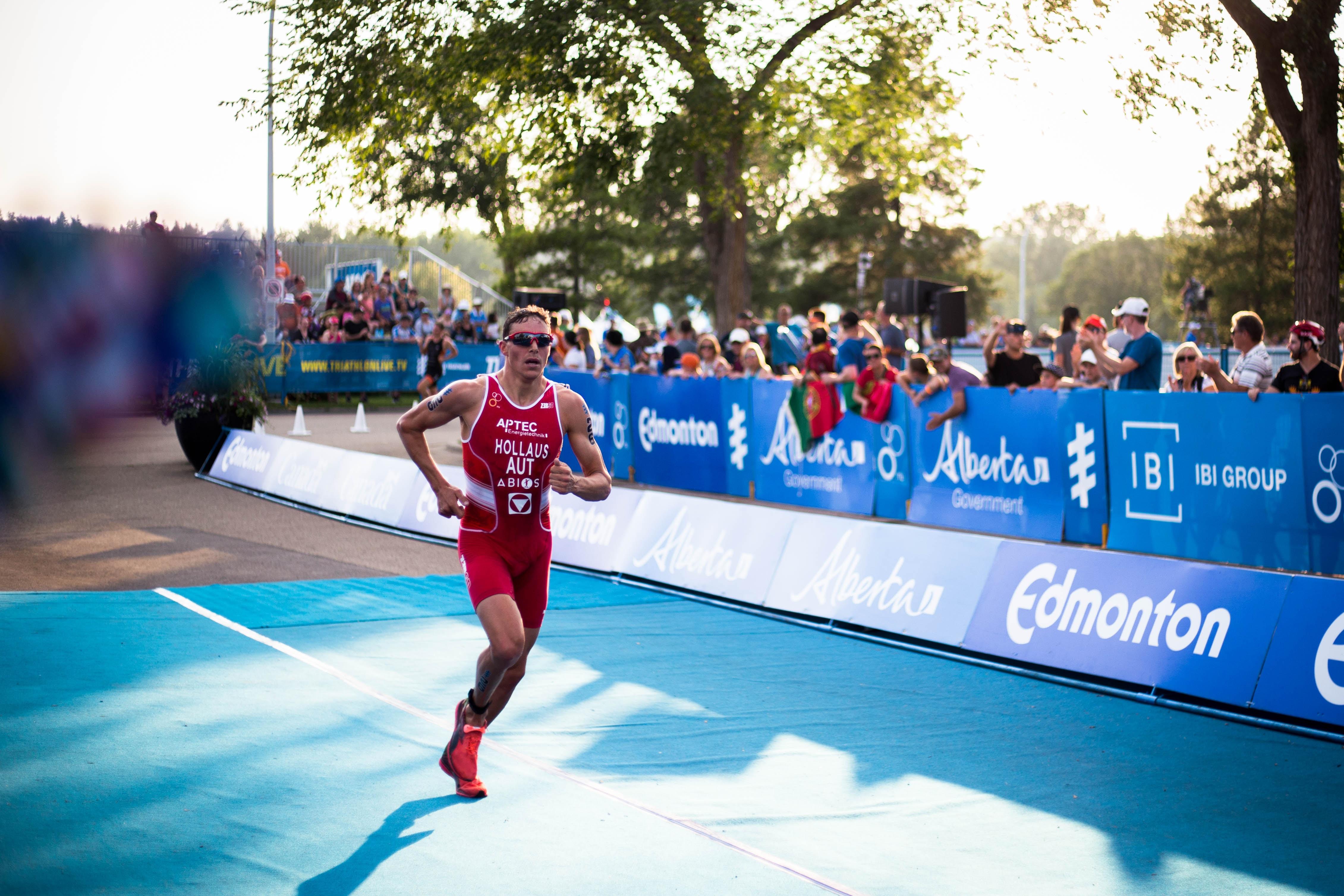 man in red tank top running